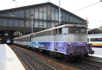 Bo-Bo Electric 116007 in en voyage livery waits to depart northbound from Paris Gare du Nord. 04/06/2011