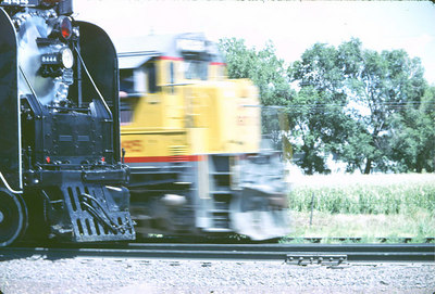 Old and New UP8444 overtaken by a Diesel Sterling, Colorado 1980's Scanned slide