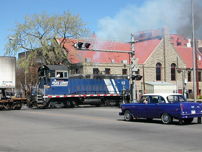 4/20/2003 Jim Harris runs the MRL 12 Billings switch engine behind the original Parmly billings Library building
