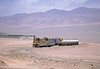 The train consisted of loaded sulphuric acid tanks, empty copper carriers and box cars. On the seaward side of the coast range it was overcast but here in the desert the sun, which was about as strong as it gets beat down.