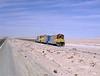 Beyond Sierra Gorda the trio of ex CN NF210s plod across the desert.