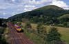 Approaching Little Stretton from the north, a shiny new 66 on the 6V78 15:25 Dee Marsh to Margam empty steel.