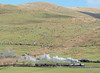 The train climbed along the slopes of Snowdon...