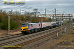 "With the sky and train tinged with sunrising colours, 90019 is heading south on the up main line at Old Linslade with 1M16, the 20:47 Inverness to Euston ""Caledonian Sleeper"" at 07:08 on Saturday 25th February 2012. Digital Image No. GMPI11093."