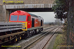 60079 has been recently outshopped in DB Schenker livery and looks a real treat. It had earlier worked 6V25 from Bescot to Hinksey and is now working the onward 6O26, 10:19 from Hinksey Yard to Eastleigh departmental train. Its wagons loaded with sleepers it is southbound through Culham station at  10:28 on the dull and very cold morning of Wednesday 8th February 2012. Digital Image No. GMPI10920.