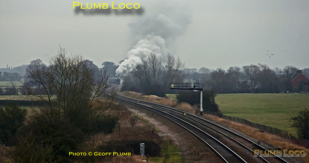 """6024 """"King Edward I"""" stopped at Challow for water from 11:33 to 12:08 and was then on its way again towards Bristol, only to run foul of an apparent signal system failure in the Shrivenham area. A down FGW HST had been standing at the signal in the picture for well over half-an-hour with the """"King"""" at the next signal and another HST behind that. Eventually the HST got the road and has gone on its way and now 6024 is starting away from the previous signal, only to get stopped at this one as well... 12:50, Sunday 12th February 2012. Digital Image No. GMPI11016."""