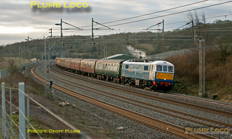 """The sun has risen into a cloudbank but nevertheless the light on 86259 is quite pleasing. The loco is hauling 1Z86, the 07:09 from Euston to Carnforth, the train then continued to Carlisle behind 70013 """"Oliver Cromwell"""". 07:43 on Saturday 25th February 2012. Digital Image No. GMPI11107."""