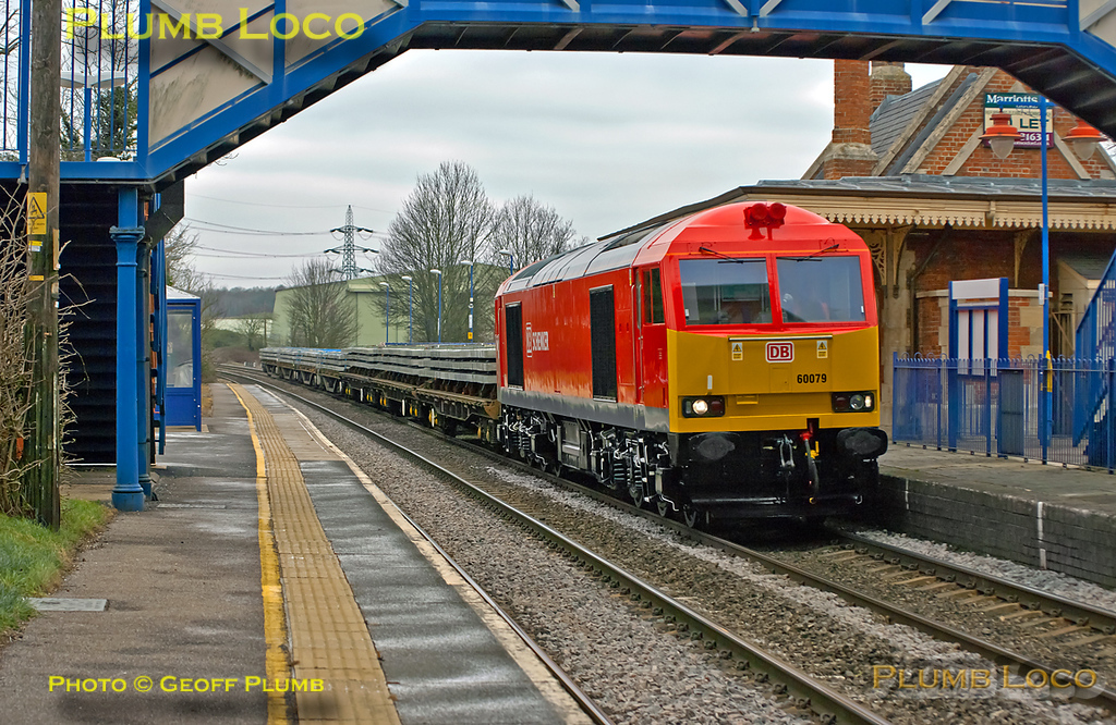 60079 has been recently outshopped in DB Schenker livery and looks a real treat. It had earlier worked 6V25 from Bescot to Hinksey and is now working the onward 6O26, 10:19 from Hinksey Yard to Eastleigh departmental train. Its wagons loaded with sleepers it is southbound through Culham station at  10:28 on the dull and very cold morning of Wednesday 8th February 2012. Digital Image No. GMPI10919.