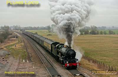 """Due to a signalling failure in the area, trains were being held at each signal for some time and a queue had built up. Having been held at the previous signal for around 30 minutes, 6024 """"King Edward I"""" moved forward to this signal just east of Shrivenham and was held for another eight minutes before getting the road. It then made a volcanic start with the 13 coaches of 1Z29, """"The Cathedrals Express"""" from Paddington to Bristol. 12:58, Sunday 12th February 2012. Digital Image No. GMPI11040."""