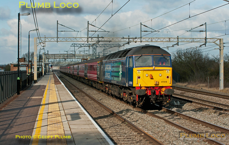 Another football special from Liverpool, 1Z24,  was also held up by the derailment at Winsford and is here running around 50 minutes late at 13:15. DRS 47818 leads the train of ex-Virgin Mk.2 stock with 47841 on the rear, through Cheddington station. This train was also booked on the slow line but was running on the fast, I was at least the right side for the light but the sun was proving reluctant to oblige! Sunday 26th February 2012. Digital Image No. GMPI11147.