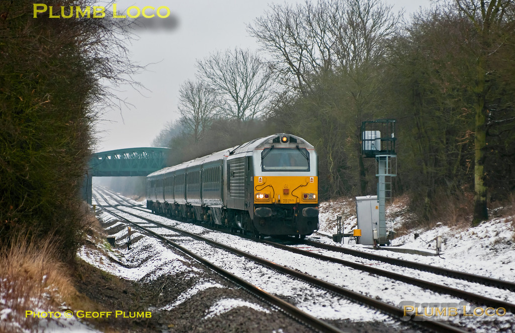 "There was a further snowfall on Monday 11th February 2013, though much of it had melted by early afternoon as 67013 ""Dyfrbont Pontcysyllte"" approaches the foot-crossing near Kingsey with 1R34, the 13:15 from Marylebone to Birmingham Moor Street, running dead on time at 13:47 with LHCS set AL02 and DVT 82302 on the rear. Digital Image No. GMPI14208."