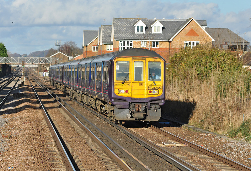 First Capital Connect 319422 is seen at Horley, heading for Brighton 11/01/2014.
