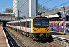Heathrow Connect Desiro 360203 is seen at Ealing Broadway about to depart for London Paddington 16/03/2014.