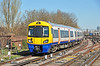 London Overground Electrostar unit 378228 arrives at Clapham Jctn 16/03/2014.<br /> A multi million pound train & a sheet of news paper is used as a sun blind, made me smile !!.
