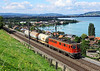 11426 Passes the shores of Lake Thun with the afternoon Thun - Leisiggbad freight seen at Einigen	<br /> 31/08/2010