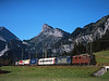 189 + 465008 seen leaving Kandersteg on a Northboung lorry train for Freiburg in Germany allowing the drivers a rest yet keeping the cargo flowing on a beautiful August morning<br /> 26/8/2006