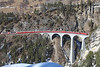 The less photographed angle at Landwasser viaduct taken from the Filisur side of the gorge sees Ge4/4lll No 644 working the 12.58hrs Chur - St Moritz	<br /> 27/02/2013