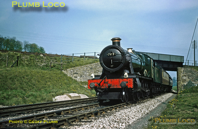 """From the Geoff Plumb Collection of original slides. GWR """"Modified Hall"""" class 4-6-0 No. 7917 """"North Aston Hall""""  has not long passed Bruton with a down express from Paddington and is passing under the Somerset & Dorset Joint line near Cole. Friday 2nd May 1958. Photo by D.E.White. Collect Slide No. 29328."""