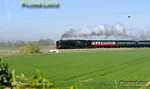 """On its first revenue earning run since its return from overhaul, BR Standard 4-6-2 No. 70000 """"Britannia"""" is running in plain black BR livery without its nameplates. It is passing Cholsey Manor Farm with 1Z71, """"The Cathedrals Express"""", 09:22 from Oxford to Canterbury and return, a few minutes late at 09:53 on Thursday 7th April 2011. Digital Image No. GMPI8492."""