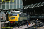 Class 47 No. 1680, later 47094, stands in Bristol Temple Meads station at the head of 1M28, presumably a Cross Country express to the Midlands. Members of a track gang are in evidence, wearing early versions of hi-viz clothing, though the person on the right only seems to have a hi-viz bobble hat! August 1972. Slide No. 8522.