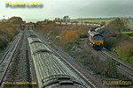 66103 comes off the Bishton flyover at Llandevenny, just east of Llanwern, with a train of coal hoppers, 4C58, 13:13 East Usk Yard to Avonmouth, while a First Great Western HST heads west for Newport and beyond. Monday 27th November 2006. Digital Image No. IMGP2217.