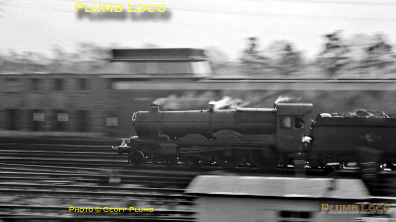"""An early attempt at a panning-shot, not altogether brilliant! GWR """"Castle"""" Class 4-6-0 No. 7031 """"Cromwell's Castle"""" races towards Paddington with an up express at Old Oak Common on Monday 29th October 1962. B&W Neg No. 225."""