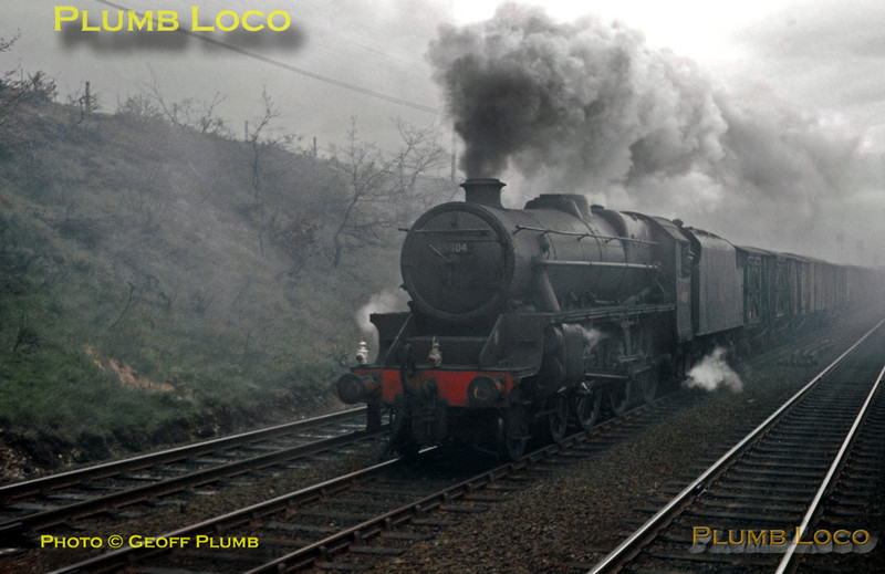 """LMS """"Black 5"""" 4-6-0 No. 44804 is working a down fitted freight along the slow line near Sandridge and is actually overtaking the train it was seen from! This was the RCTS/LCGB joint """"North Midlands Railtour"""" hauled by SR """"West Country"""" 4-6-2 No. 34006 """"Bude"""", which was struggling for steam pressure en route to Derby. Saturday 11th May 1963. Slide No. 30."""