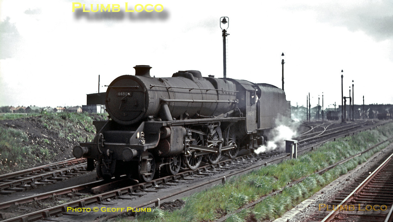 "Stanier ""Black 5"" 4-6-0 No. 44800 comes off shed at Chester MPD for its next duty on Saturday 7th May 1966, seen from a passing train from Crewe. Slide No. 1989."