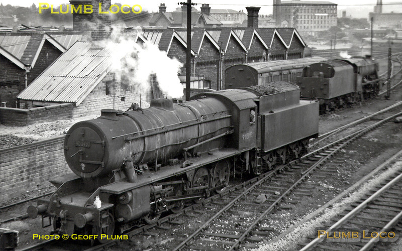 "WD ""Austerity"" 2-8-0 No. 90397 in typically filthy condition for the class on the headshunt of the shed yard at Mirfield MPD (56D). Beyond is an unidentified 8F 2-8-0 and a rather nice old departmental carriage. Summer 1966."