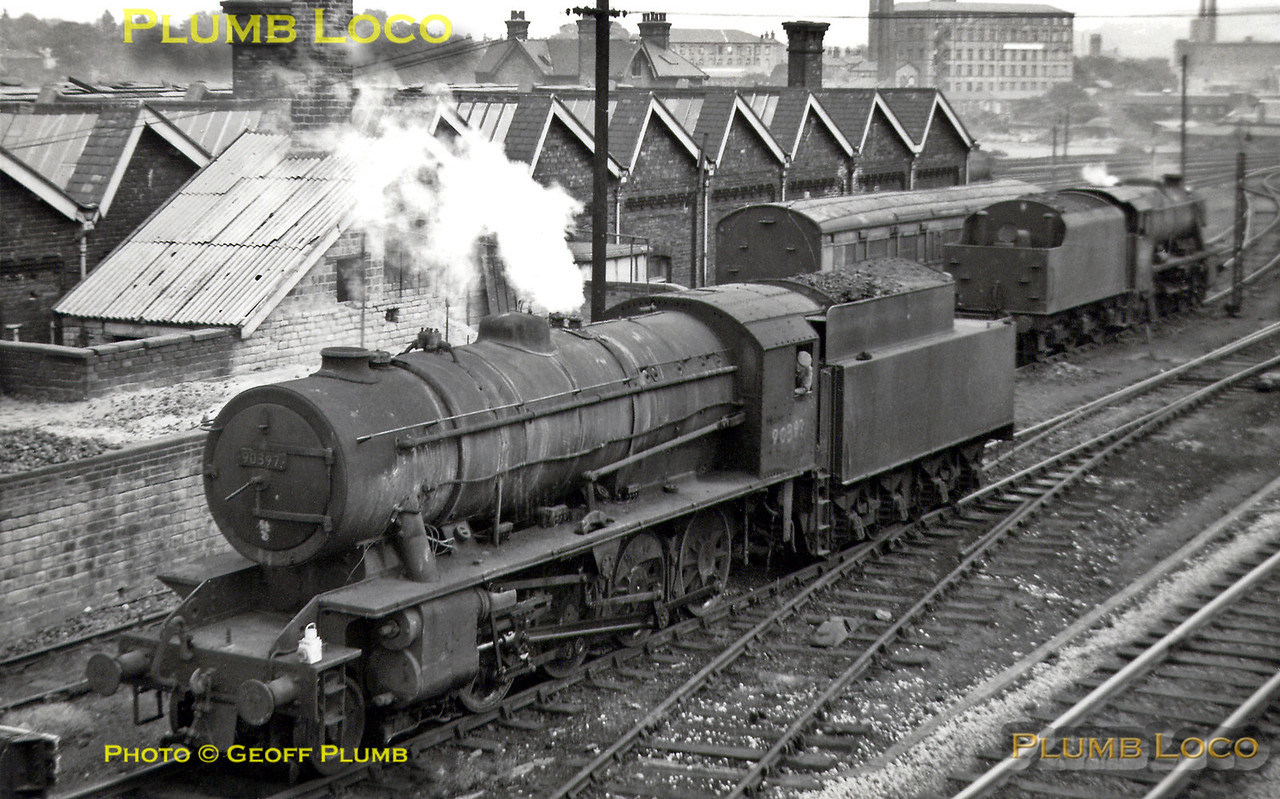 """WD """"Austerity"""" 2-8-0 No. 90397 in typically filthy condition for the class on the headshunt of the shed yard at Mirfield MPD (56D). Beyond is an unidentified 8F 2-8-0 and a rather nice old departmental carriage. Summer 1966."""