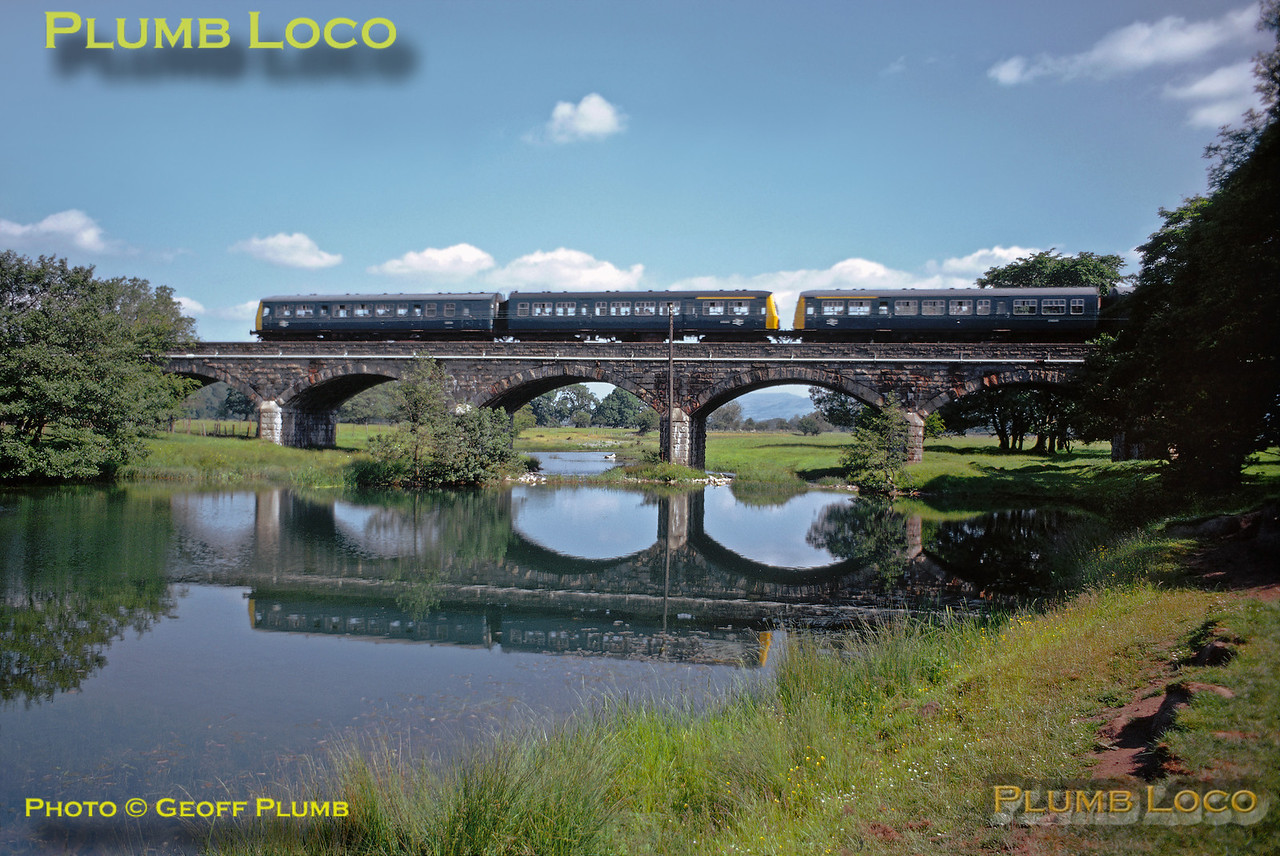 A Leeds to Morecambe DMU crosses the River Lune on the viaduct near Melling at around mid-day on Saturday 21st June 1975. Slide No. 13216.