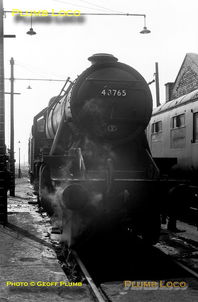 LMS Stanier 8F 2-8-0 No. 48765 simmers at its home shed, 10D Lostock Hall, on Saturday 1st June 1968, during the last few weeks of steam operation in the area.