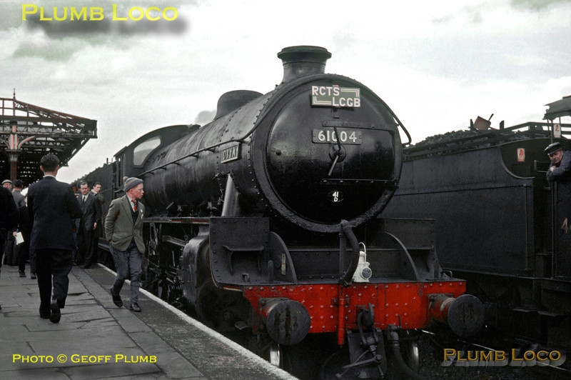 """LNER B1 Class 4-6-0 No. 61004 """"Oryx"""" having just arrived at Burton-upon-Trent with the joint RCTS/LCGB """"North Midlands Railtour"""". Already, the """"Class 1"""" headcode lamps have been changed to  """"light engine"""" as it is about to be replaced by Bulleid """"West Country"""" Class 4-6-2 No. 34006 """"Bude"""" for the return run to London St. Pancras. The crew of an LMS 4F 0-6-0 alongside watch proceedings. Saturday 11th May 1963. Slide No. 40."""