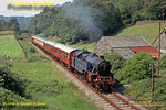 On the Lakeside & Haverthwaite Railway, ex-LMS Fairburn 4MT 2-6-4T No. 2085 is working a train from Haverthwaite to the shores of Lake Windermere in lovely countryside at Newby Bridge. The loco looks rather fine in its spurious Caledonian Railway livery! June 1975. Slide No. 13243.