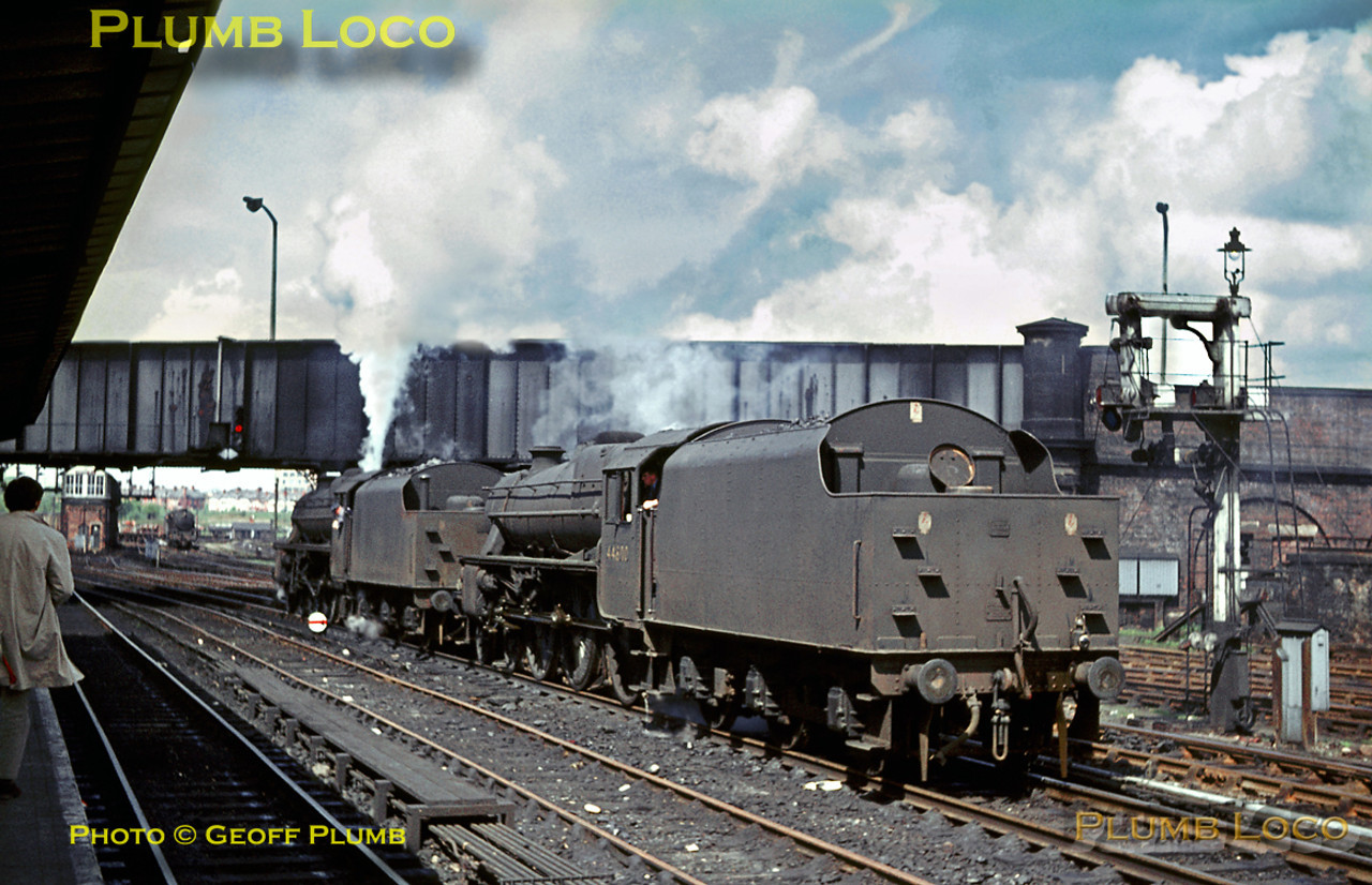 """Black 5"" Class 4-6-0s No. 45283 & 44800 are two separate light engines which have just come off shed and are now waiting alongside Chester station before continuing their journeys. Another ""Black 5"" No, 45424 is approaching in the background by the LNWR signalbox with an up freight train. Saturday 7th May 1966. This was prior to the resignalling scheme and many LNWR lower quadrant semaphore signals still remained. Slide No. 1991."