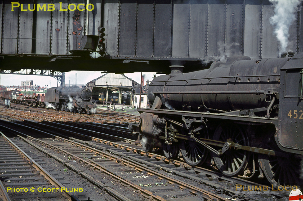 """Black 5"" 4-6-0 No. 45283 is waiting for the road in the foreground as classmate 45424 heads in the opposite direction with an up freight train at Chester station, Saturday 7th May 1966. Slide No. 1992."