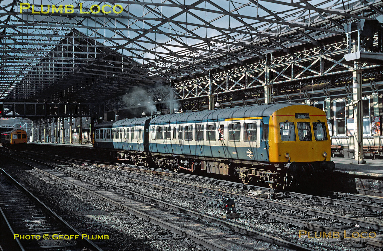 Class 101 DMU with DMCL E51499 leading and DMBS E51431 trailing depart from a sun-dappled Huddersfield station with a working to Wakefield Westgate on Saturday 10th April 1982. Slide No. 15639.