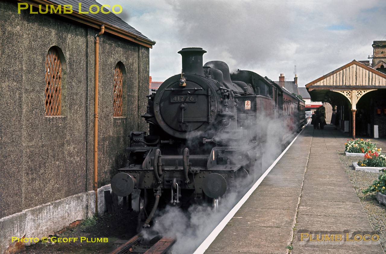"""Ivatt Class 2MT 2-6-2T No. 41226 was one of those fitted with equipment for working """"Auto-trains"""" and is here in the platform at Amlwch station having just arrived from Bangor with its two-coach train. It is now preparing to depart once more on the long branch to Gaerwen, across the Menai bridge and back to Bangor. Tuesday 27th August 1963. Slide No. 294."""