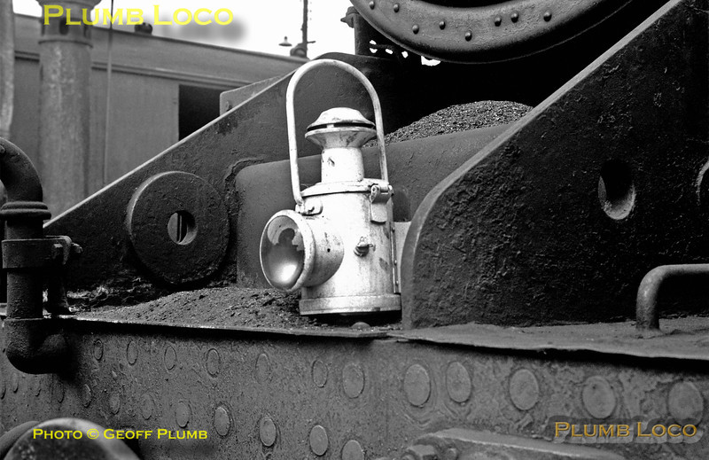 """A single oil headlamp sits on the bufferbeam of an unidentified """"Black 5"""", surrounded by ash from the smokebox, as the engine sits in the yard at Lostock Hall shed on Saturday 1st June 1968."""