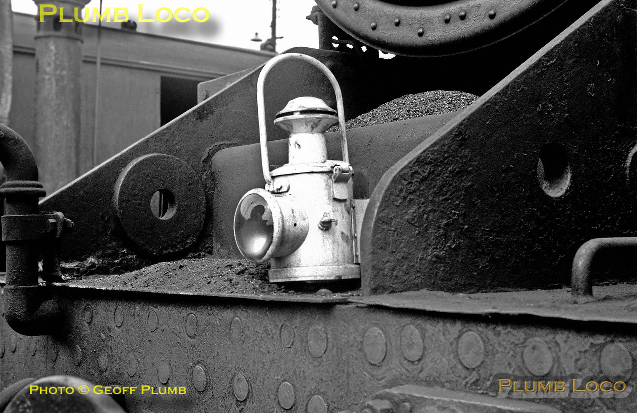 "A single oil headlamp sits on the bufferbeam of an unidentified ""Black 5"", surrounded by ash from the smokebox, as the engine sits in the yard at Lostock Hall shed on Saturday 1st June 1968."