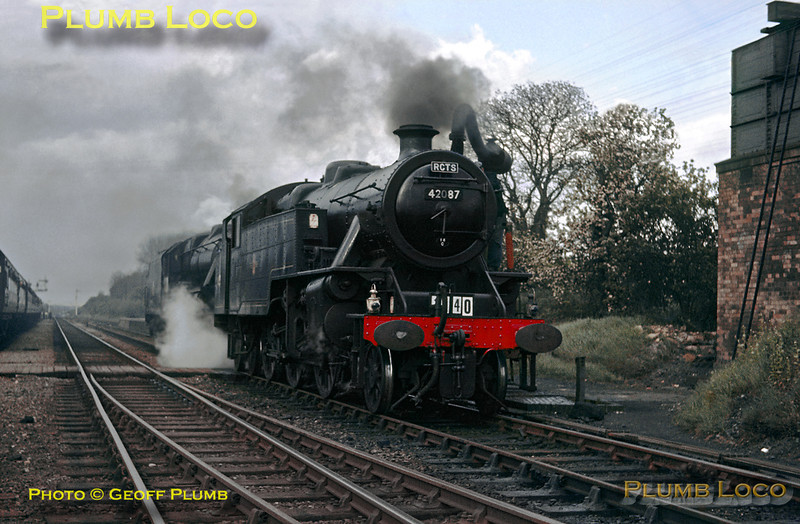 """Having arrived at Luffenham from the Seaton Junction direction, the locos have come off the train to take water and run round before departing for Manton Junction. LMS Fairburn 2-6-4T No. 42087 is coupled ahead of """"Black 5"""" 4-6-0 No. 45238 as they work the RCTS """"Joint Lines Railtour"""" on Saturday 18th May 1963. Slide No. 50."""