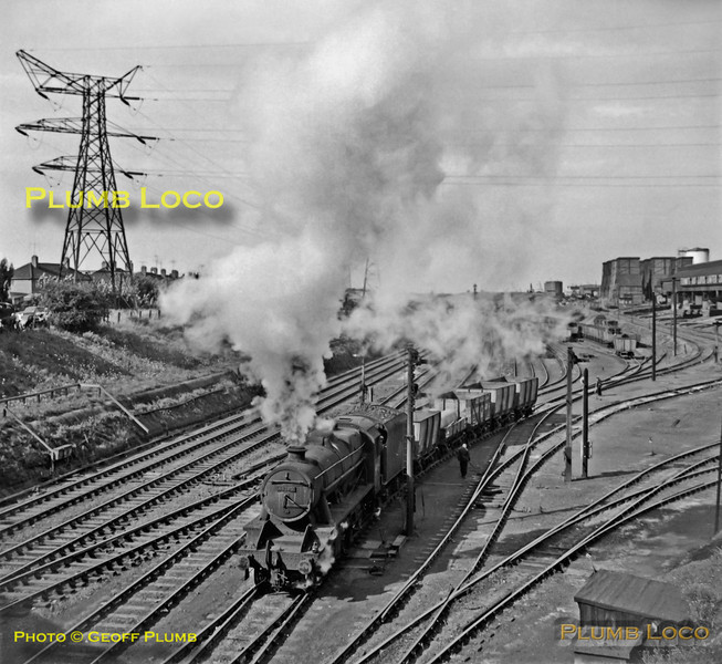 Stanier 8F 2-8-0 No. 48285 is shunting in the yard at Stewarts & Lloyds steel works in Corby, alongside the Midland main line, on Friday 10th August 1962. B&W Neg No. 123.