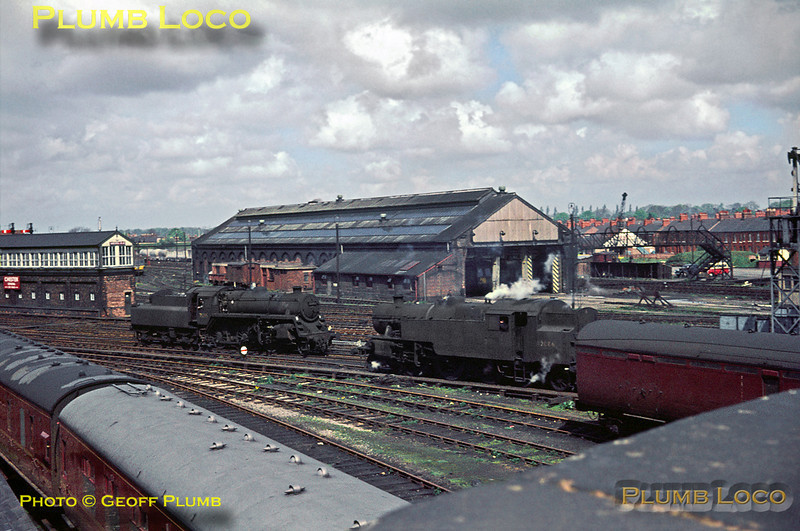 LMS 2-6-4T No. 42086 and BR Standard 4MT 2-6-0 No. 76095 are both working light engine, but in opposite directions as they are about to pass at Chester General station on Saturday 7th May 1966. On the left is one of the old LNWR signalboxes and in the centre is the former GWR engine shed, by this time housing DMUs. Slide No. 1994.