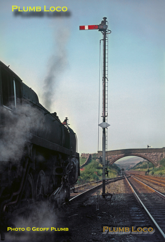 BR Standard 9F 2-10-0 No. 92123 has stopped for water alongside the water tank in the down loop at Blea Moor, with a train of empty wagons bound for Long Meg. Blea Moor Tunnel can be in the distance. Monday 21st August 1967. Slide No. 3035.