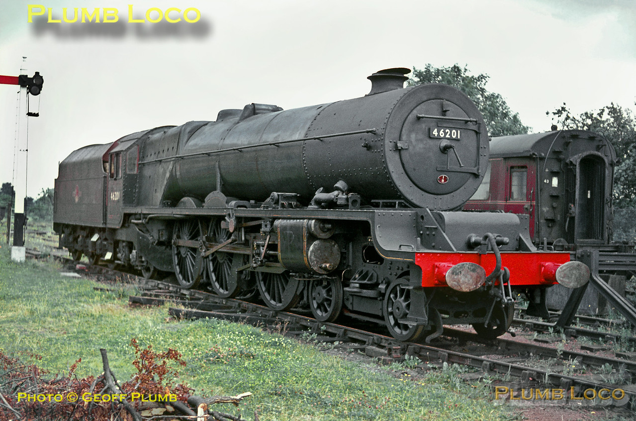 "LMS Stanier ""Princess Royal"" Class 4-6-2 No. 46201 ""Princess Elizabeth"" was stored for a while at Dowty's yard in Ashchurch, prior to restoration to main line running.  Almost in ""as bought"" condition from BR here she is on Sunday 4th July 1965. Slide No. 1389. There is also a 3D version of this shot in the ""Three Dimensional!"" collection."