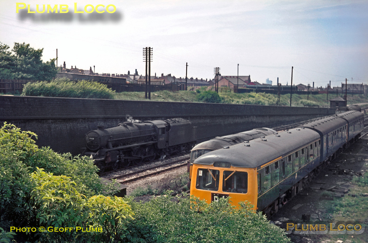 """Black 5"" 4-6-0 No. 45420 is running tenderfirst towards Manchester Victoria, passing the depot at Dean Lane where a three-car DMU in part green and part blue livery is stabled, along with a couple of diesels of Class 24 and 25. Saturday 1st June 1968. Slide No. 3315."