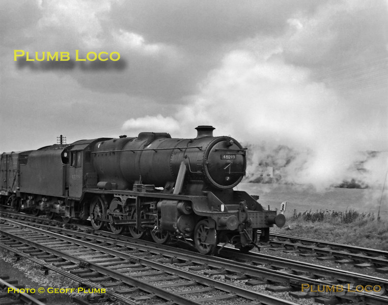 Stanier 8F 2-8-0 No. 48099 blows off steam as it plods northwards with a Class H freight train along the Midland main line at Ford Lane Crossing, Breadsall, north of Derby on Friday 17th August 1962. B&W Neg No. 162.