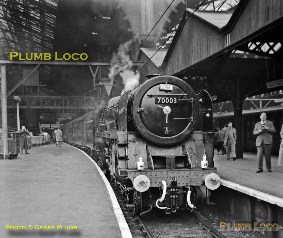 """BR Standard """"Britannia"""" Class 4-6-2 No. 70003 """"John Bunyan"""" stands at Liverpool Street station at the head of an RCTS special, the """"Great Eastern Commemorative"""" tour, billed as the """"Last Steam High Speed Run to Norwich"""", Saturday 31st March 1962. The engine had been turned out in immaculate condition by its home depot at March. B&W Neg No. 2."""