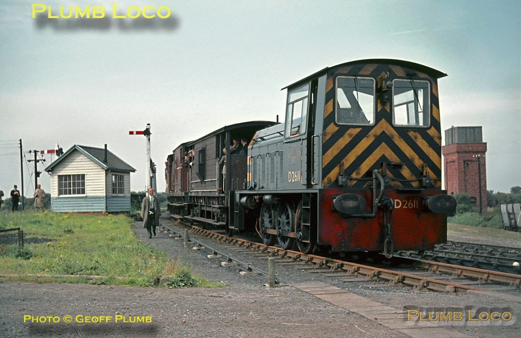 Hunslet 204hp 0-6-0DM No. D2611 (BR Class 05) stands at Reedness Junction on the Isle of Axholme Light Railway (Lancashire & Yorkshire Railway and North Eastern Railway Joint line) with an RCTS Brake Van special which started from Goole. It is now about to run to Fockerby at the end of the branch, before returning and taking the other line south towards Haxey. Saturday 14th September 1963. D2611 was a member of the class built between 1955-61 and was withdrawn in December 1967, being sold to the NCB for further use at Yorkshire Main Colliery, finally being scrapped in December 1976. Slide No. 371.