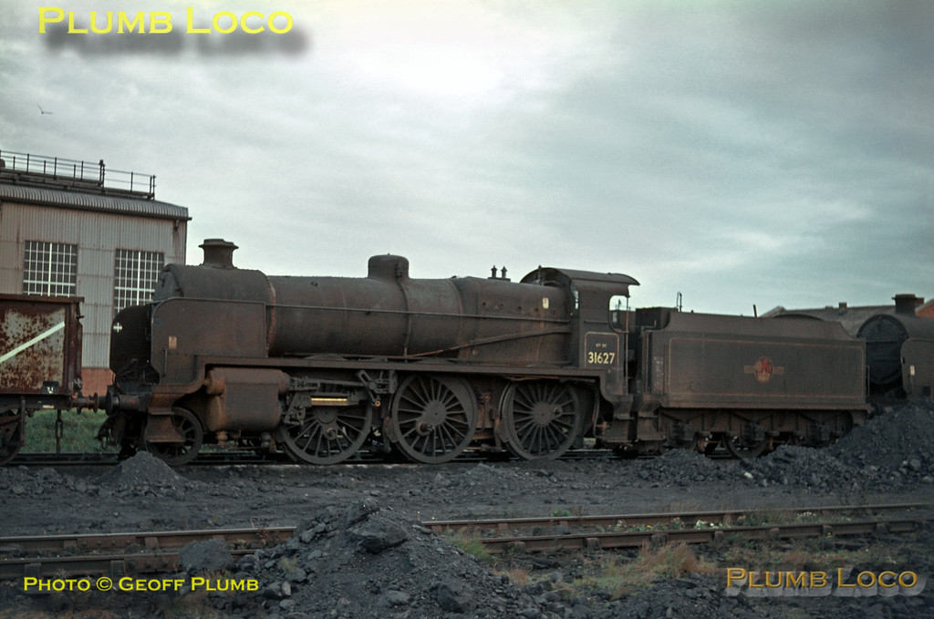 SR U Class 2-6-0 No. 31627 is dumped out of use at Eastleigh depot, its motion already stripped down prior to its final move for scrapping. It was one of the class retaining its SR style chimney as many of the locos were fitted with BR standard types in later years. Saturday 6th November 1965. Slide No. 1705.